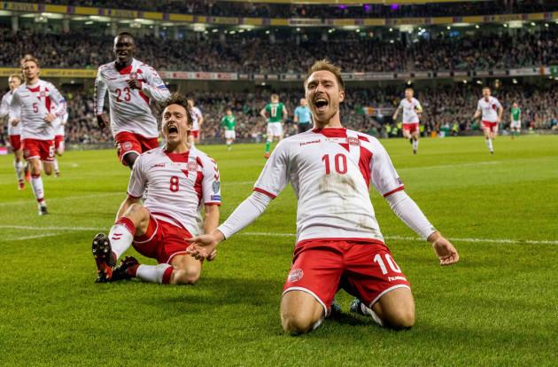 Christian Eriksen celebrates scoring their third goal with Thomas Delaney