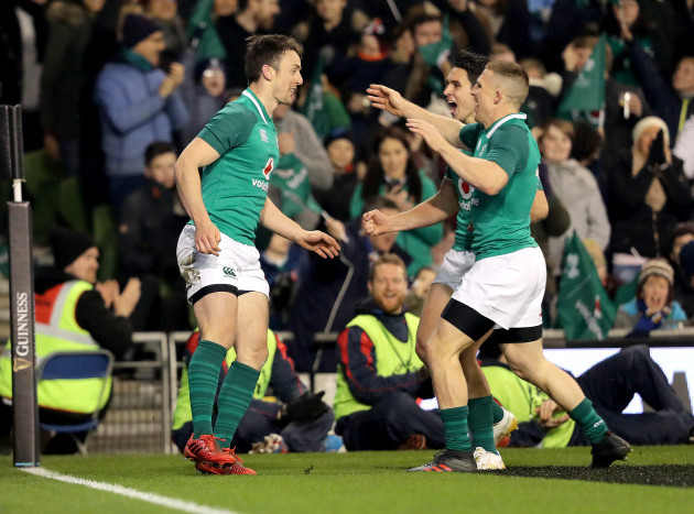 Darren Sweetnam celebrates his try with Joey Carbery and Andrew Conway