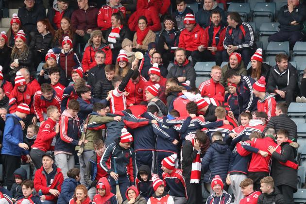 Cuala fans celebrate a goal