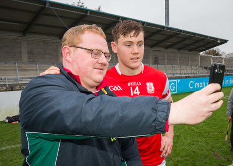 Con O'Callaghan takes a selfie with a fan after the match