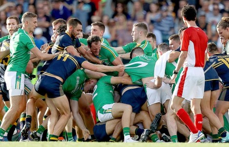 A fight breaks out between the two sides before half time