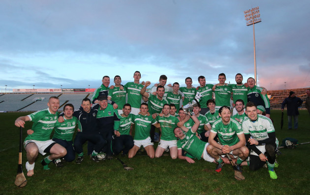 Kilmallock team celebrate with the trophy after the game