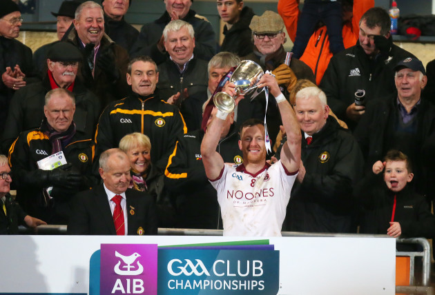 Patsy Bradley lifts the cup after they win the final
