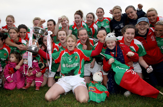 Marie Corbett celebrates with the trophy