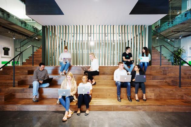 Team meeting on the steps of SurveyMonkey's San Mateo HQ