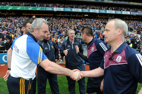 Michael Ryan shakes hands with Micheal Donoghue after the game