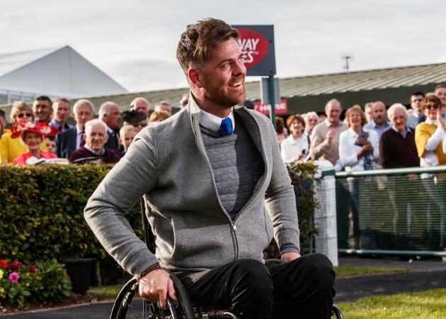 Robbie McNamara celebrates after winning with Cascavelle