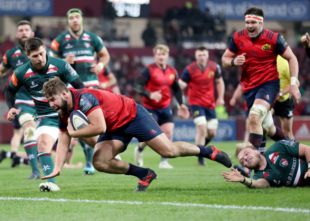 Rhys Marshall scores a try despite the efforts of Luke Hamilton