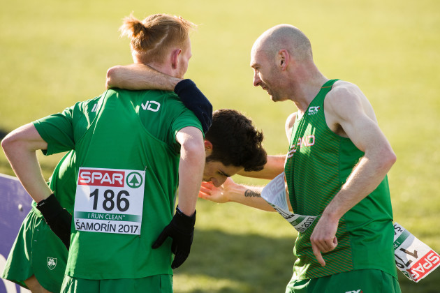 Sean Tobin, Hugh Armstrong and Kevin Maunsell celebrate after their team finished in fifth place