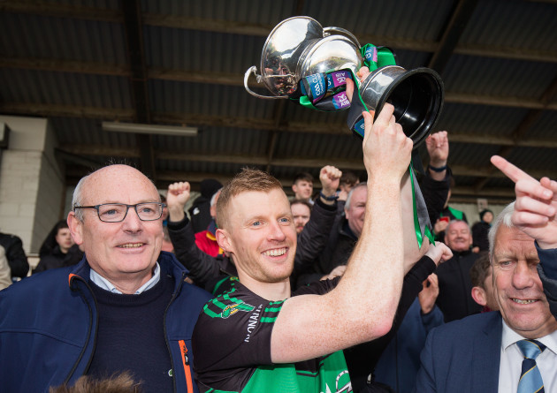 Aidan O'Reilly lifts the trophy
