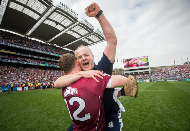 Michael Donoghue celebrates with Jonathan Glynn