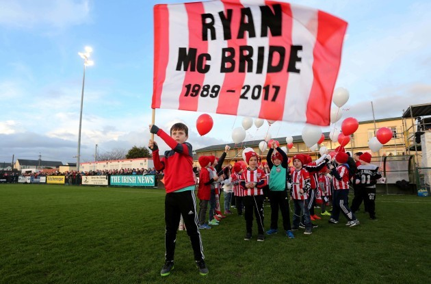 Members of the Derry City FC Cubs who released balloons in memory of club captain Ryan McBride prior to kick off