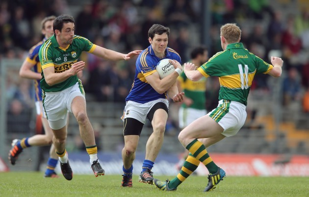 Anthony Maher and Colm Cooper tackle Ciaran McDonald