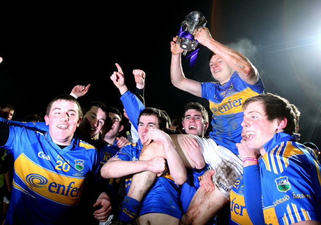 Players hold up captain Ciaran McDonald