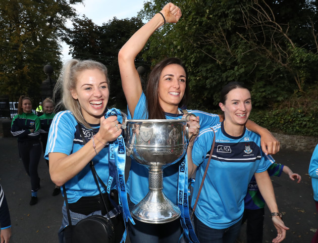 Nicole Owens, Sinead Aherne and Niamh McEvoy arrive with the cup