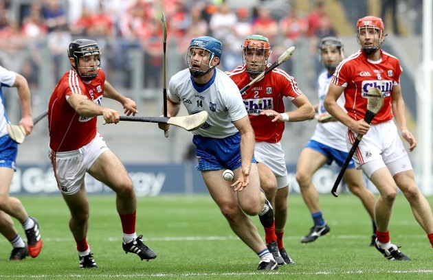 Michael Walsh of Waterford evades the Cork defence