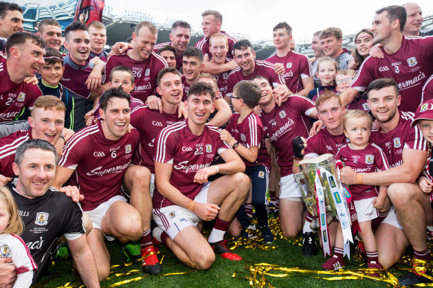 Galway players celebrate with the Liam MacCarthy cup