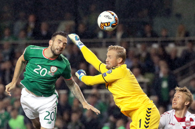Shane Duffy scores their first goal past Kasper Schmeichel