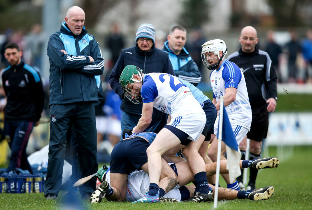 Players from both sides scuffle as Dublin manager Pat Gilroy looks on