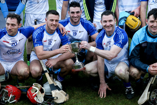 Alan Moore, Keith Connolly and Niall Corcoran celebrate with the trophy
