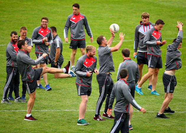 Cork players inspect the pitch