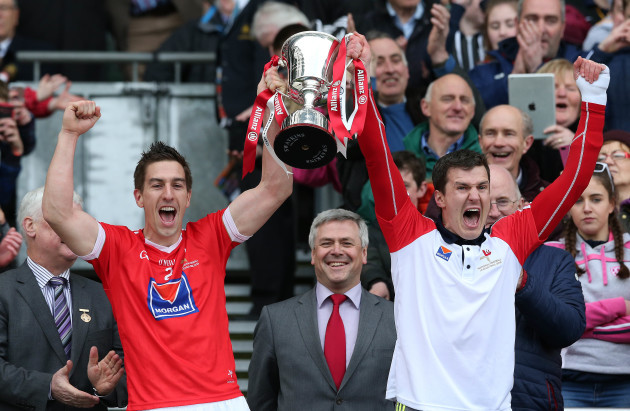 Padraig Rath and Adrian Reid lift the cup