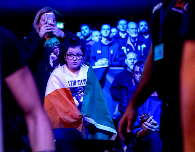 A young fan waits for Katie Taylor to arrive