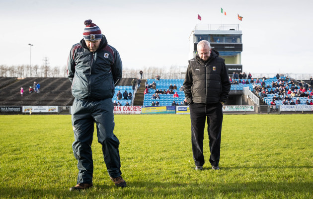 Kevin Walsh inspects the pitch