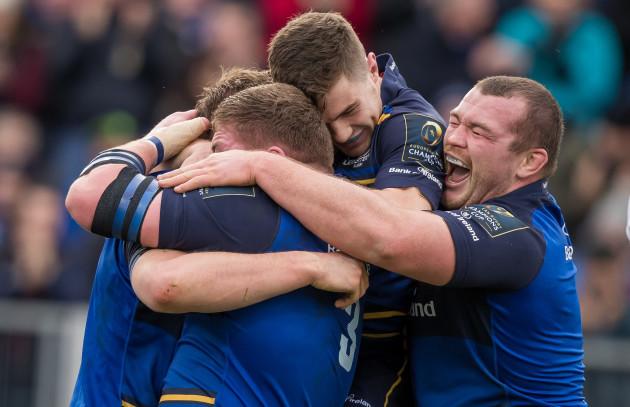 Tadhg Furlong, Jack McGrath and Luke McGrath celebrate with try scorer Jordi Murphy
