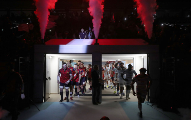Munster and Racing make their way out onto the pitch