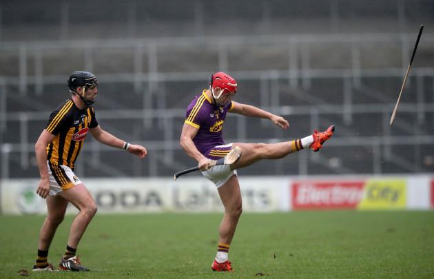 Lee Chin kicks Conor O'Shea's hurl out of play