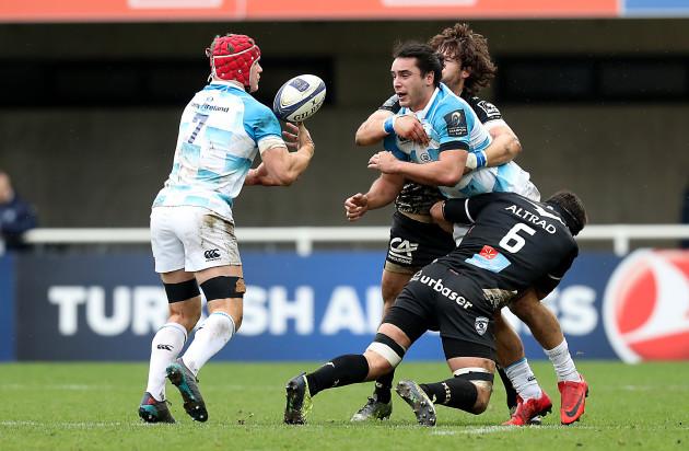 James Lowe offloads to Josh van der Flier in the tackle from Kelian Galletier
