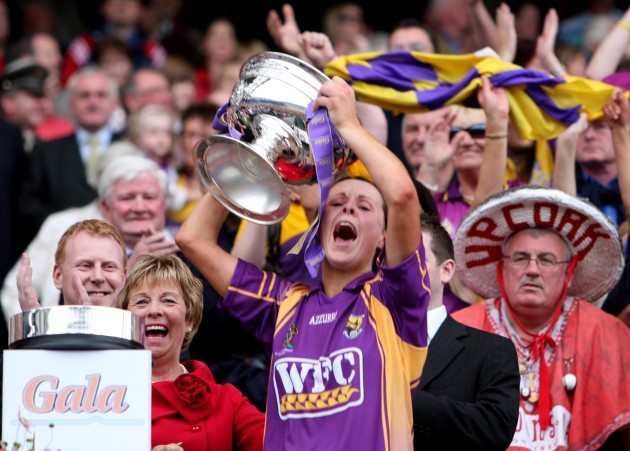 Mary Leacy lifts the cup