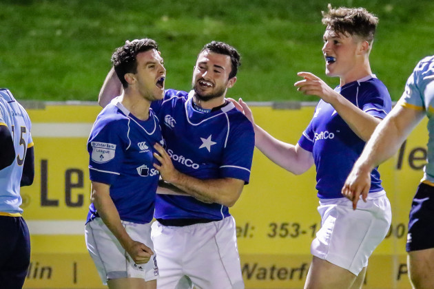 Dave Fanagan celebrates his try with teammates
