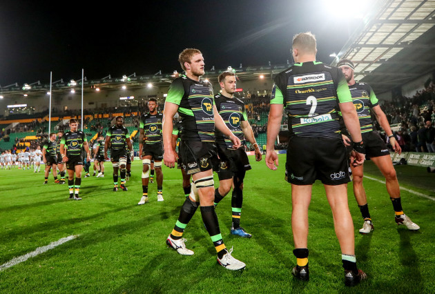 Jamie Gibson and Stephen Myler dejected after the game