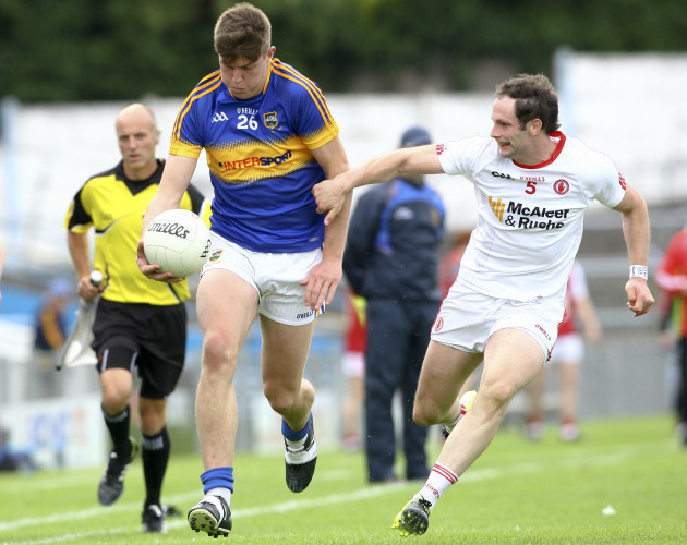 Steven O'Brien in action against Ronan McNabb