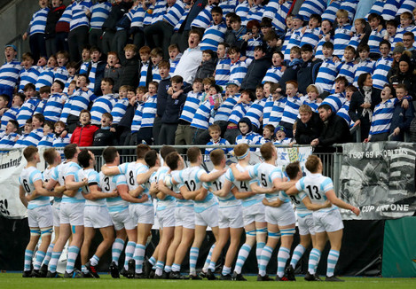 Blackrock College players greet the fans as they enter the pitch