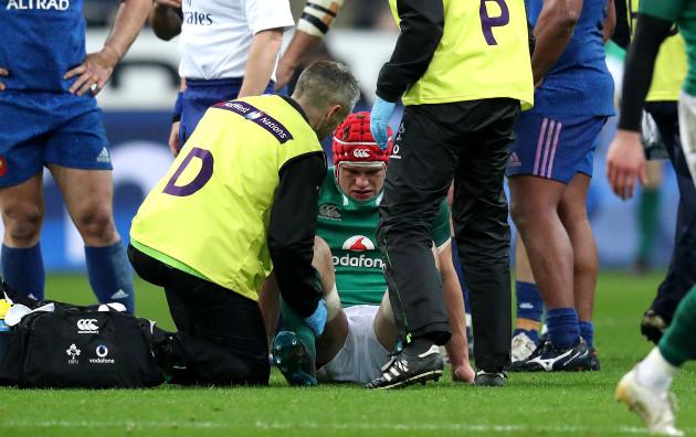 Josh van der Flier receives attention for an injury