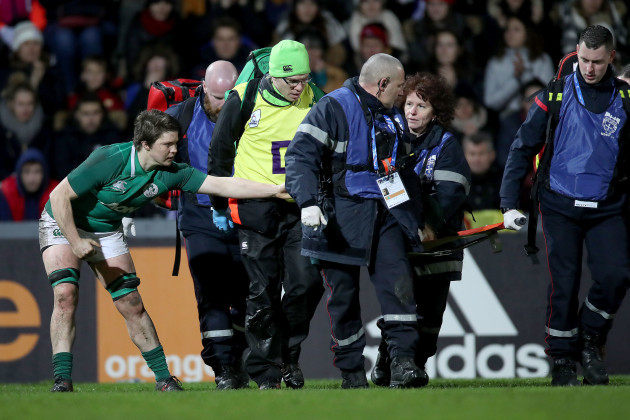 Ciara Griffin checks on Ciara Cooney as she is stretchered off