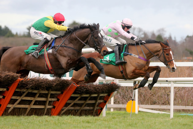 Robbie Power on Supasundae with Paul Townend on Faugheen going over the final fence