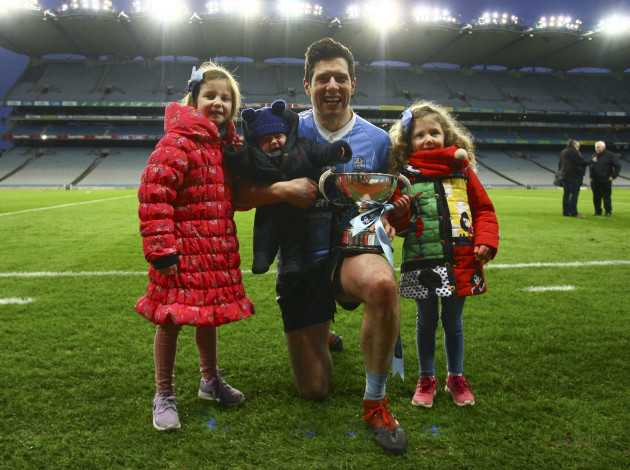 Sean Cavanagh poses with his kids Clara, Sean and Eva at the end of the game