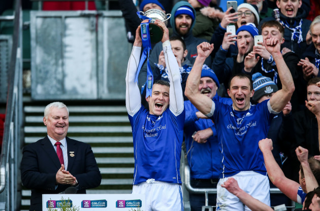 Declan Prendergast and Seamus Prendergast lift the trophy