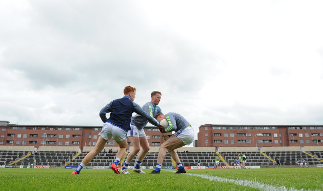 Laois players warm up before the game