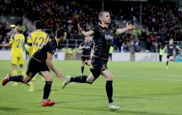 Ciaran Kilduff celebrates scoring a goal with Robbie Benson
