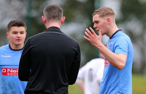 Georgie Kelly appeals to the referee after receiving  a red card