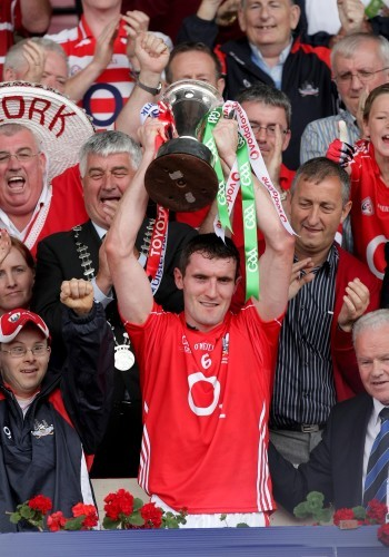 Captain Graham Canty raises the Munster Senior Football trophy