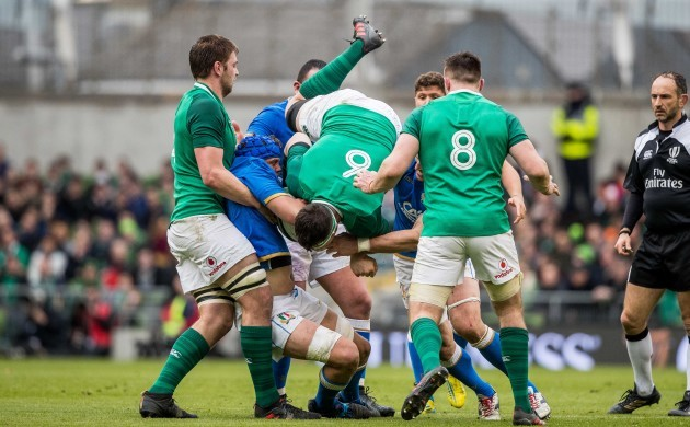 Peter O'Mahony is lifted off his feet by Simone Ferrari