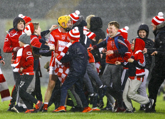 Cuala's supporters celebrate with Cian Waldron at the end of the game