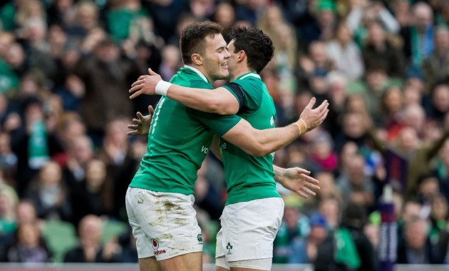 Jacob Stockdale celebrates scoring their seventh try with Joey Carbery