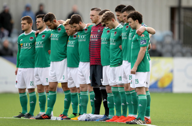 Cork City players stand for a minutes silence in memory of Liam Miller